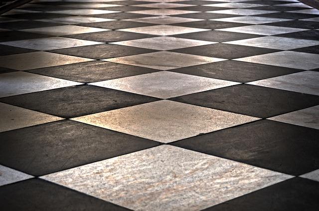 Comment installer des carreaux de céramique sur un plancher de béton ...